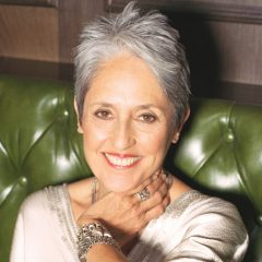 Joan Baez Sitting On A Leather Couch