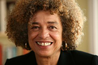 A Close Up Of Angela Davis Smiling For The Camera