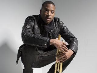 Trombone Shorty Sitting In A Chair
