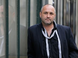 Colum McCann Standing In Front Of A Building