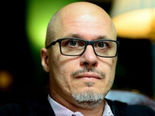 Aleksandar Hemon Wearing Glasses And Looking At The Camera