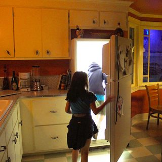 A Person Standing In A Kitchen