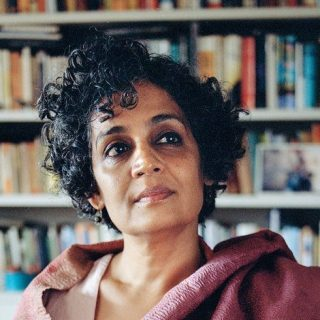 Arundhati Roy Looking At A Book Shelf