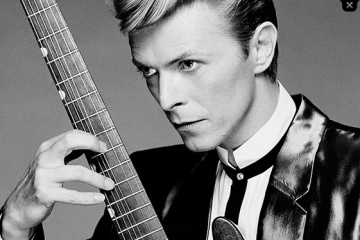 David Bowie Holding A Guitar