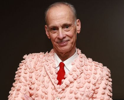 John Waters Wearing A Pink Dress