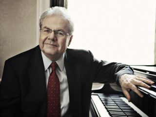 Emanuel Ax Wearing A Suit And Tie In Front Of A Piano
